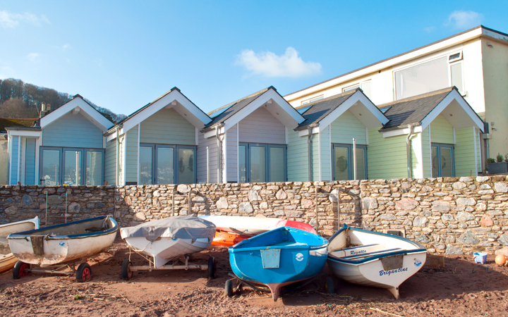 Photo of beach huts and boats