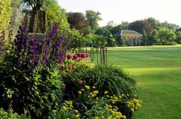 Flower beds beside a wide lawn
