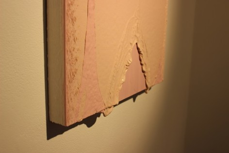 Canvas with pink paint dripping from it