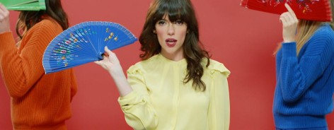 Singer Natalie Prass in a yellow shirt against a red background