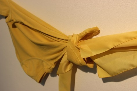 Yellow t-shirt tied to a yellow scarf