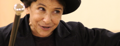 Photo of Kathryn Hunter in a black bowler hat