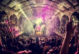Photo of the Albert Hall with pink lights and lazers