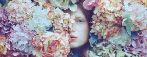 Woman's face among flowers