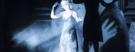 Blue lit woman on stage