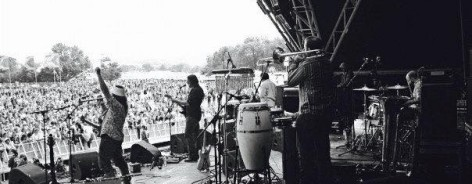 Black and white shot of band playing at festival