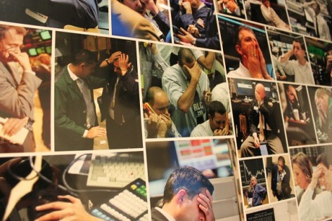 Photo montage of traders with their hands on their heads