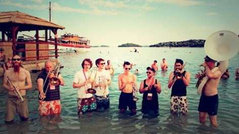 Photo of Riot Jazz Band standing in the sea