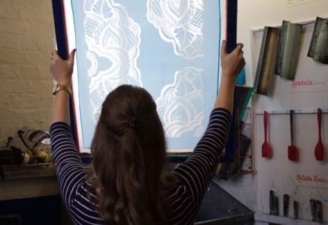 Stephanie Lawton holds up a screen print
