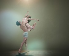 Man lifts woman in ballet move