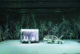 Snowy stage with a broken down car