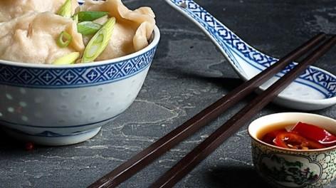 Bowl of dumplings with chop sticks