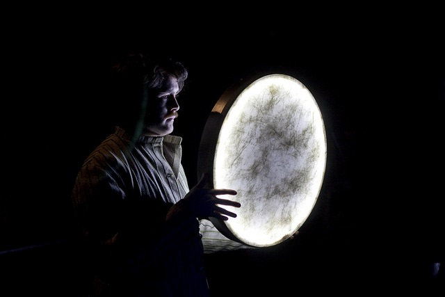 Photo of a man holidng a moon