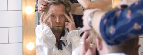 Comedian Tony Law being made up for the stage