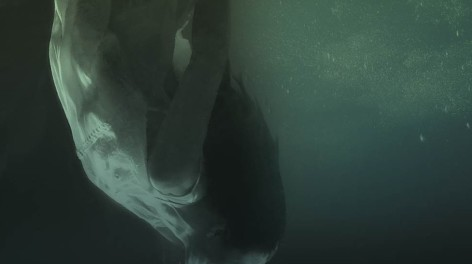 Photo of a woman sinking under water