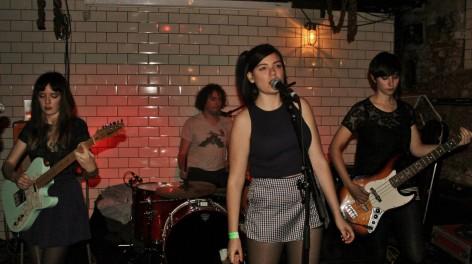 A woman singing in a basement bar