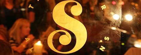 The gold sign for Saison