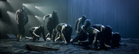 Photo of the Furies climbing across stage