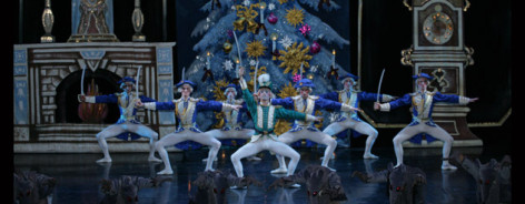 Soldiers dancing in front of a Christmas tree in The Nutcracker