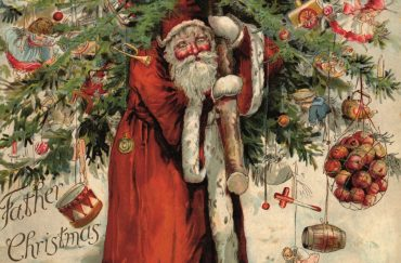 Santa carrying a decoration laden tree