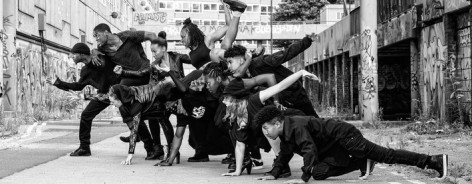Black and white photo of dancers in a still pose
