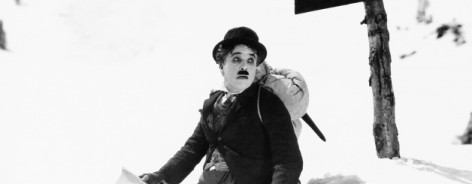 Black and white still of Charlie Chaplin in the snow