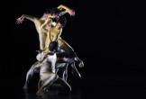 A column of dancers in gold