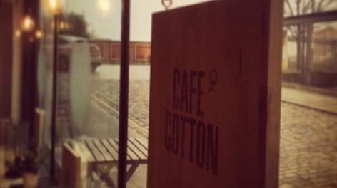 Sign in Cafe Cotton's window