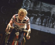 Woman on a bicycle on stage