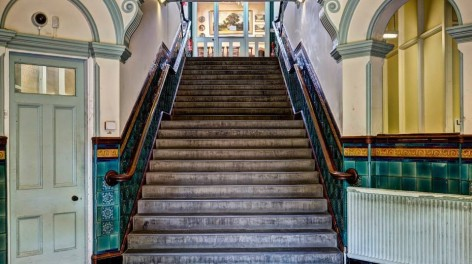 Photos of stairs to Levenshulme Antiques Village.