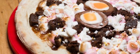 Sweet Easter pizza with cream egg on top