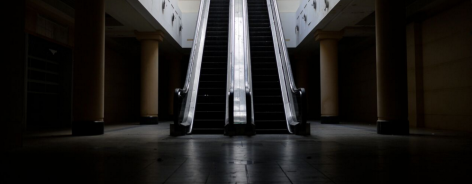 Two escalators lit starkly