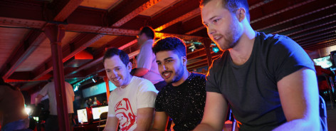 Men playing on video games