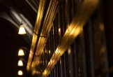Lights above the bookcases in Chetham's Library