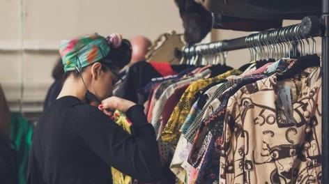 Woman looking through clothes racks