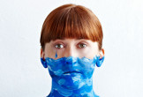 Liz Green with blue paint on face