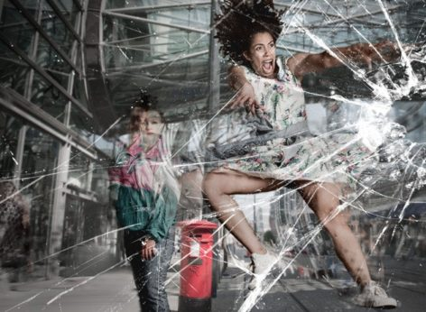 Woman jumping into glass