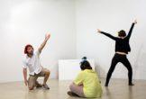 Audience members performing art