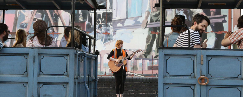 Liz West performing on a train platform