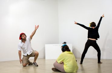 People gesturing in an exhibition