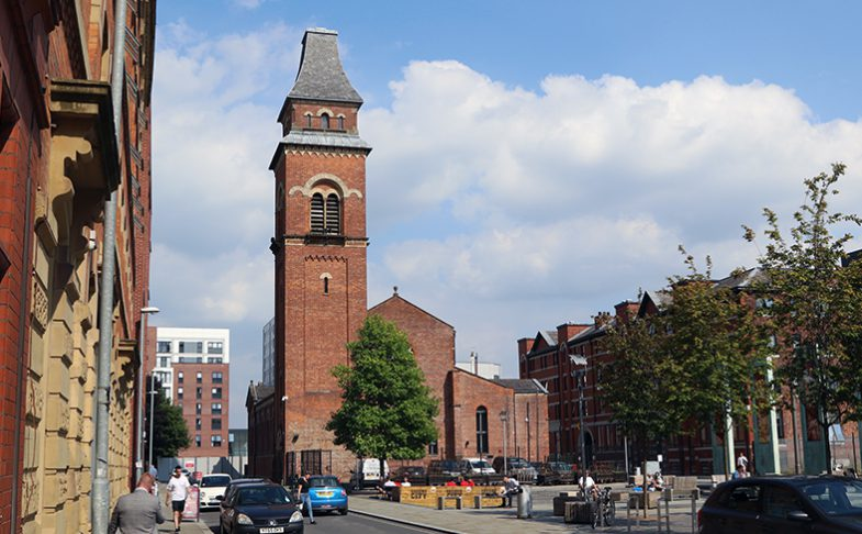 Image of Halle St Peters from across Cutting Room Square in Ancoats, Manchester.