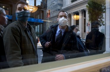 People on the street wearing anti-infection face masks .