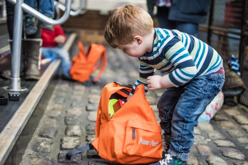 Child with orange ruck sack - part of spring family fun