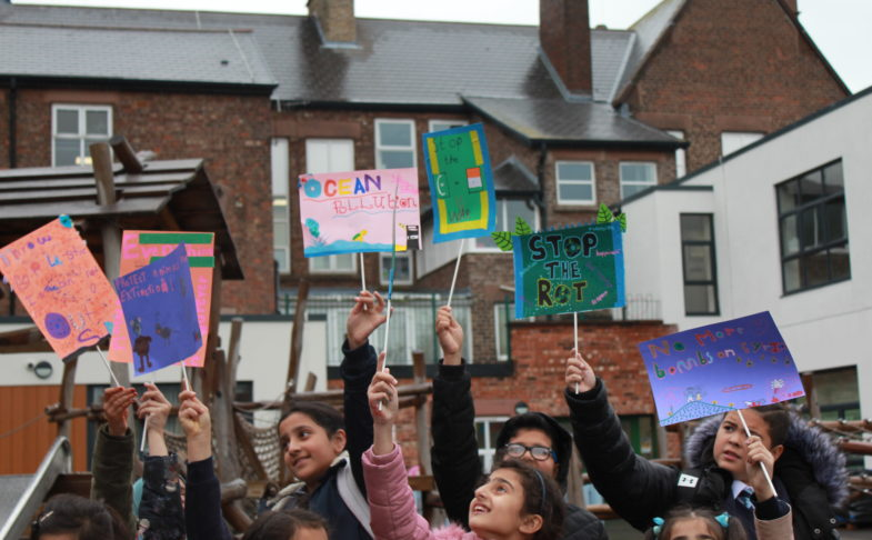 Children protesting with placards, made in a family workshop