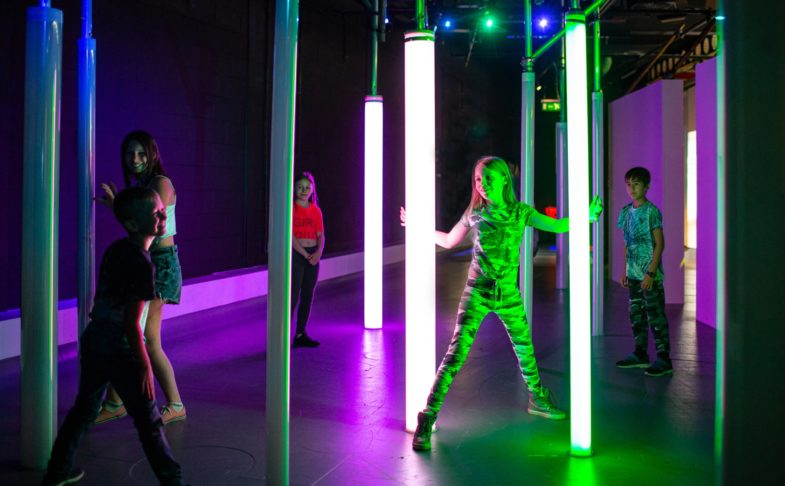 Digital Dimensions at Eureka! Children playing in digital dimensions with light pillars