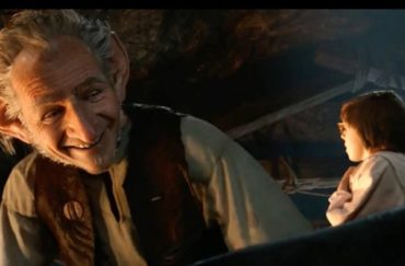 Screen shot from the film of the BFG by Roald Dahl, showing head and shoulders of the BFG looming over Sophie