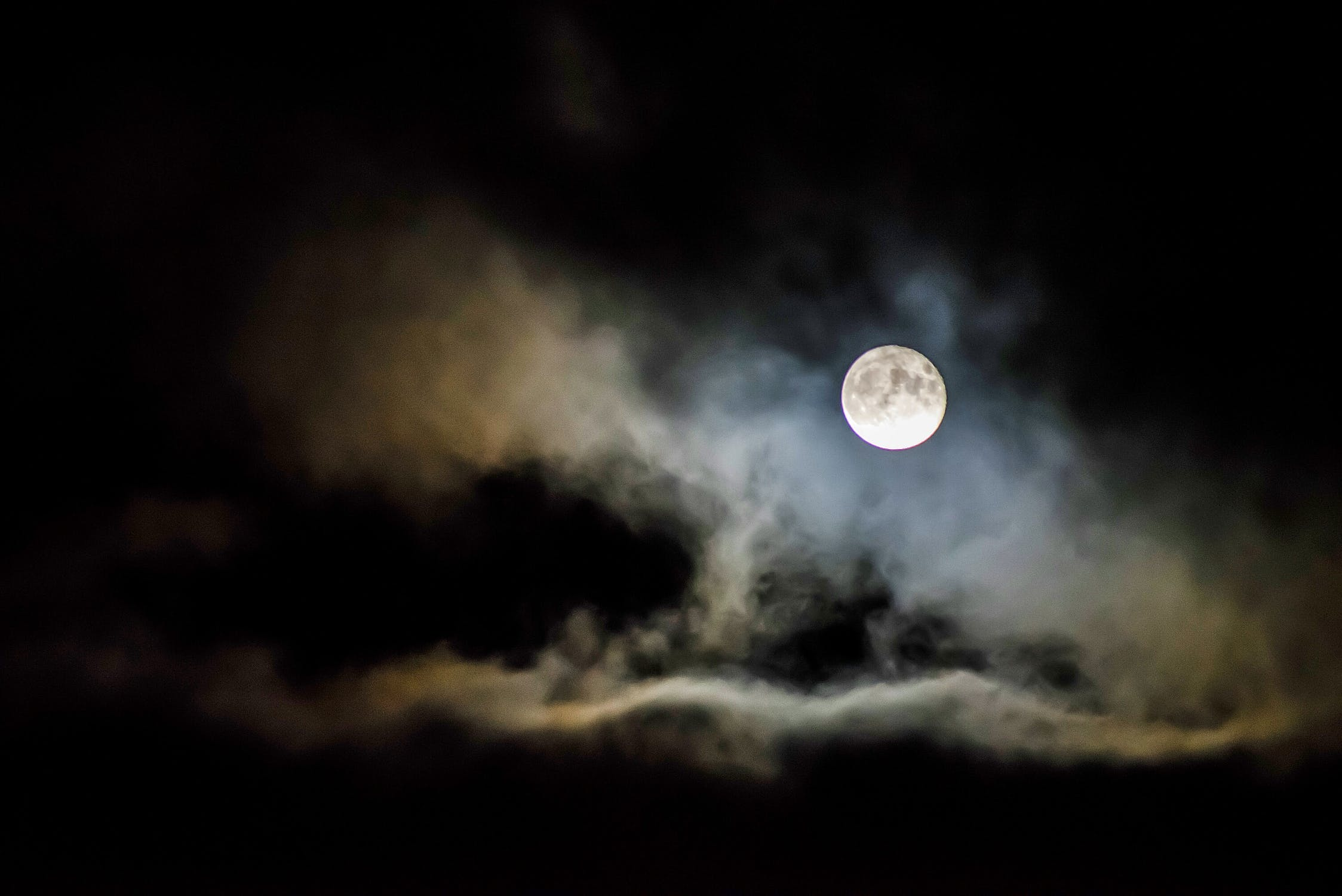 the moon in the night sky as explored in the planetarium shows