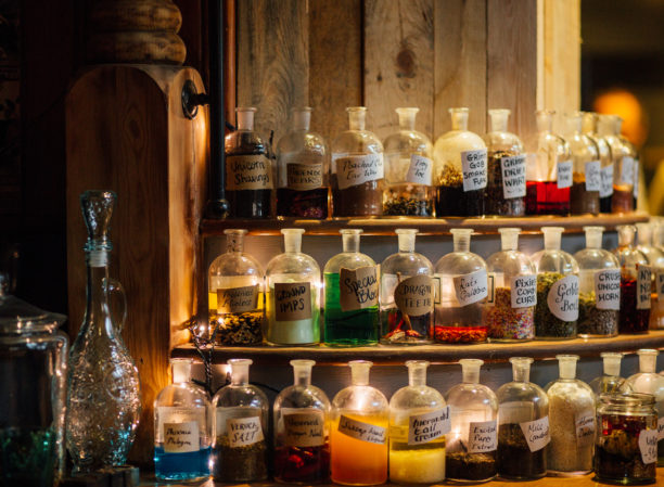 Grimm & Co Takeover event - bottles of various colours shown on shelves. They look like magical potions!