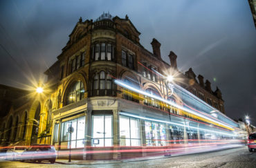 Building shown in evening with colourful blurred lights - for 3D printing architecture workshop