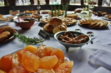 Table laid with Tudor festive treats as part of Yuletide event.